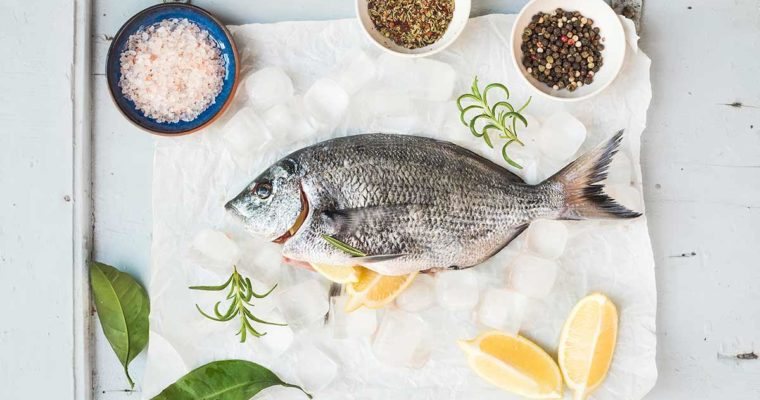 Sea bream fish with lemon, herbs