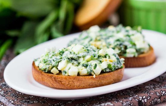 Sandwich with eggs salad, green herb, parsley, ramson, spring onions
