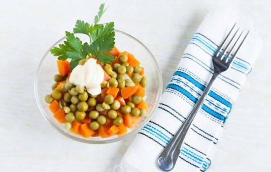 Vegetarian salad with canned peas, boiled carrots